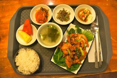 Korean BBQ Chicken set meal (served with tofu, anchovies, kimchi, sliced fruits, soup, rice)