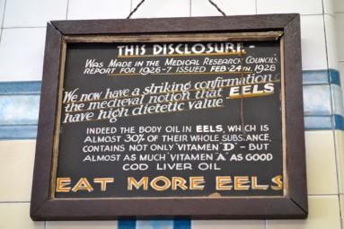 f cooke eel antique sign