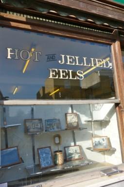 f cooke eel glass sign